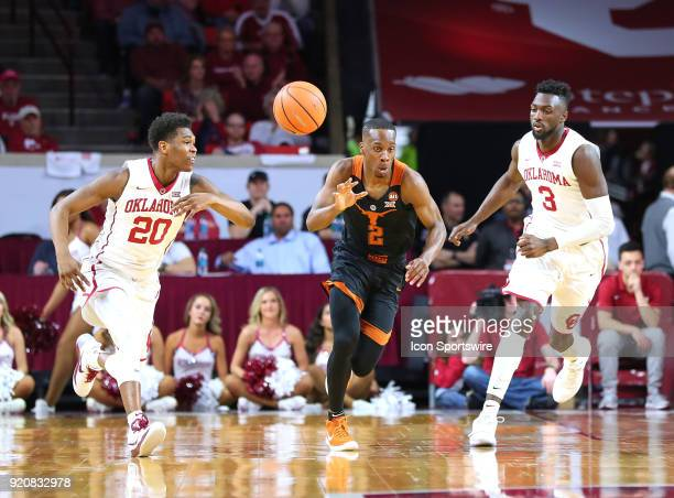 Oklahoma Sooners Guard Kameron McGusty causes Texas Longhorns Guard Matt Coleman to lose the ball during a college basketball game between the...