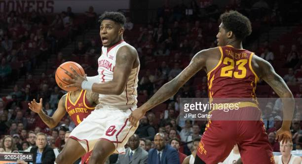 Oklahoma Sooners guard Rashard Odomes looks to pass the ball as Iowa State Cyclones guard Donovan Jackson and Iowa State Cyclones forward Zoran...