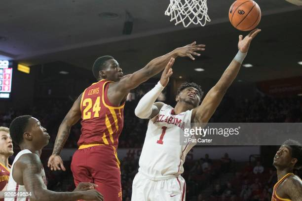 Oklahoma Sooners guard Rashard Odomes shoots as Iowa State Cyclones guard Terrence Lewis applies pressure during the second half of a NCAA college...