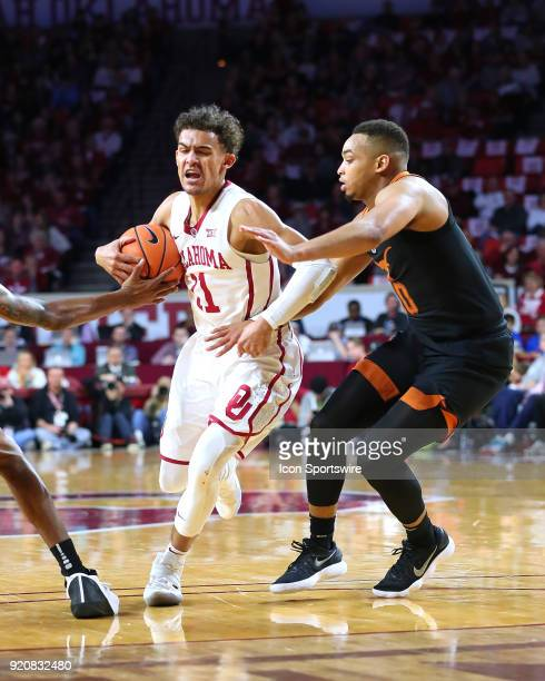 Oklahoma Sooners Guard Trae Young and Texas Longhorns Guard Eric Davis during a college basketball game between the Oklahoma Sooners and the Texas...