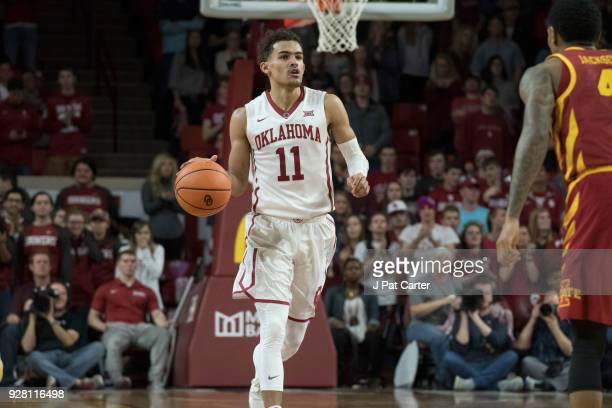 Oklahoma Sooners guard Trae Young brings the ball up court against Iowa State during the second half of a NCAA college basketball game at the Lloyd...
