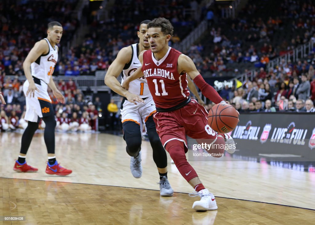 Oklahoma Sooners guard Trae Young (11) drives the baseline in the first half of a first round matchup in the Big 12 Basketball Championship between the Oklahoma Sooners and Oklahoma State Cowboys on March 7, 2018 at Sprint Center in Kansas City, MO.
