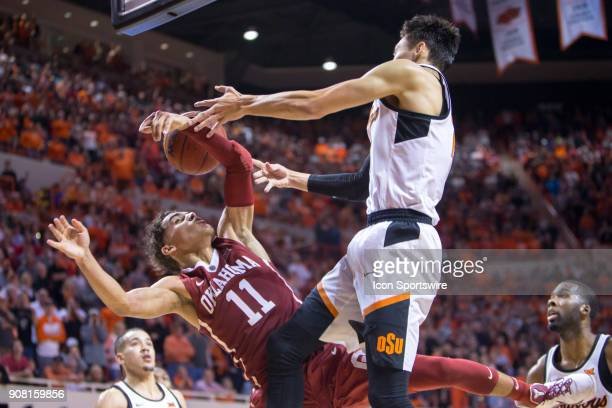 Oklahoma Sooners guard Trae Young gets tangled up under the basket during the college Big 12 conference mens basketball game between the Oklahoma...