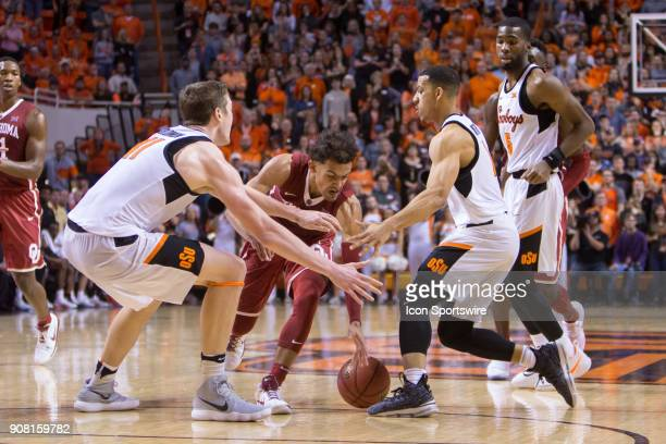 Oklahoma Sooners guard Trae Young goes after a loose ball during the college Big 12 conference mens basketball game between the Oklahoma Sooners and...