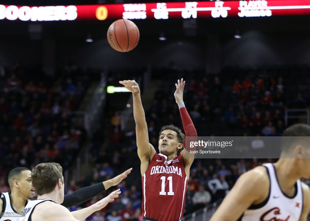 Oklahoma Sooners guard Trae Young (11) shoots a three in the first half of a first round matchup in the Big 12 Basketball Championship between the Oklahoma Sooners and Oklahoma State Cowboys on March 7, 2018 at Sprint Center in Kansas City, MO.