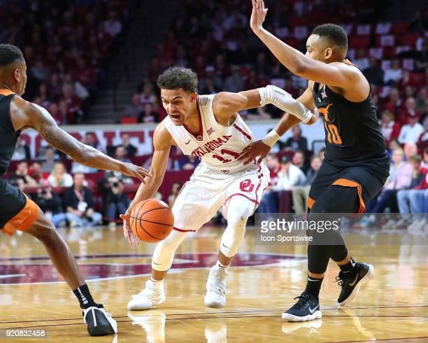 Oklahoma Sooners Guard Trae Young splits two Texas defenders during a college basketball game between the Oklahoma Sooners and the Texas Longhorns on...