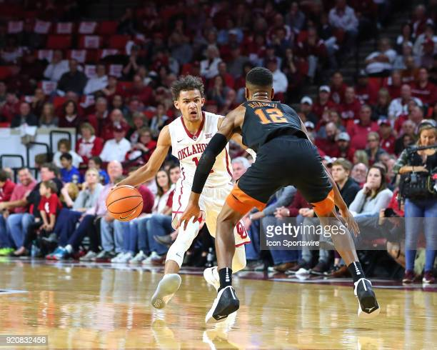 Oklahoma Sooners Guard Trae Young works against Texas Longhorns Guard Kerwin Roach II during a college basketball game between the Oklahoma Sooners...