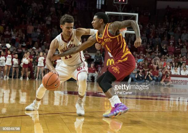Oklahoma Sooners guard Trae Young works his way around Iowa State Cyclones guard Donovan Jackson during the second half of a NCAA college basketball...