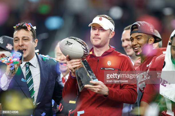 Oklahoma Sooners head coach Lincoln Riley celebrates with the Big 12 Championship trophy during the Big 12 Championship game between the Oklahoma...