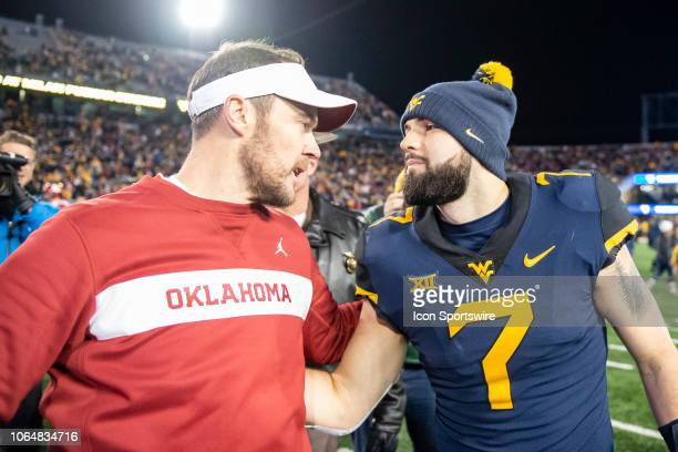 Oklahoma Sooners Head Coach Lincoln Riley greets West Virginia Mountaineers Quarterback Will Grier after the Oklahoma Sooners versus the West...