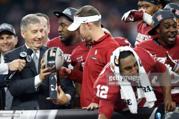 Oklahoma Sooners head coach Lincoln Riley is handed the Big 12 championship trophy by Big 12 Commissioner Bob Bowlsby during the Big 12 Championship...
