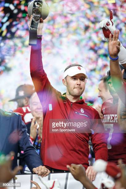 Oklahoma Sooners head coach Lincoln Riley lifts the championship trophy during the Big 12 Championship game between the Oklahoma Sooners and the TCU...