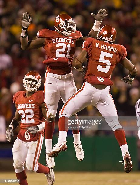 Oklahoma Sooners linebacker JR Bryant and defensive back Nic Harris celebrated after recovering a fumble from Missouri Tigers quarterback Chase...