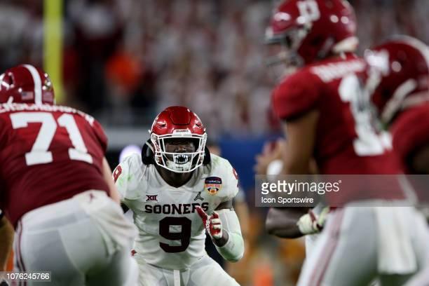 Oklahoma Sooners linebacker Kenneth Murray reacts to Alabama Crimson Tide quarterback Tua Tagovailoa during the second quarter of the CFP Semifinal...