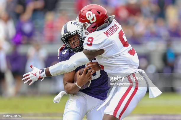 Oklahoma Sooners linebacker Kenneth Murray tackles TCU Horned Frogs quarterback Shawn Robinson during the game between the Oklahoma Sooners and TCU...