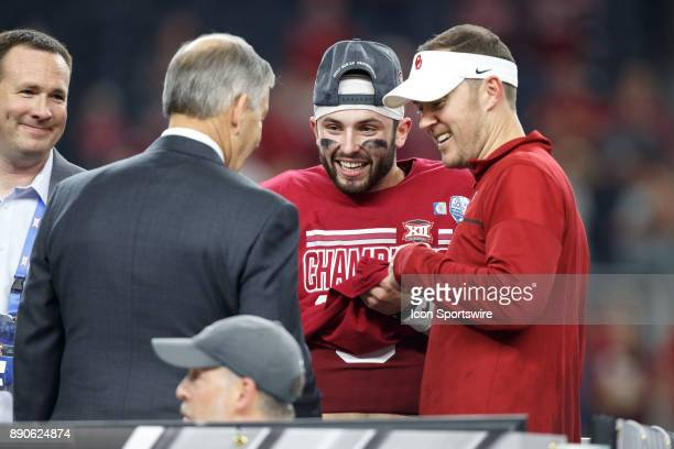 Oklahoma Sooners quarterback and head coach Lincoln Riley talk to Big 12 Commissioner Bob Bowlsby during the Big 12 Championship game between the...