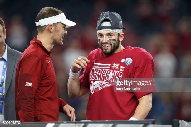 Oklahoma Sooners quarterback Baker Mayfield and head coach Lincoln Riley celebrate during the Big 12 Championship game between the Oklahoma Sooners...