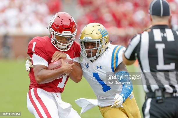 Oklahoma Sooners quarterback Kyler Murray left is tackled by UCLA Bruins defensive back Darnay Holmes right during the UCLA Bruins game versus the...