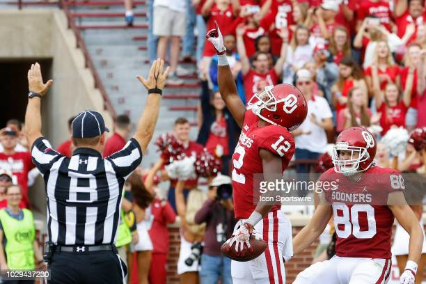 Oklahoma Sooners wide receiver AD Miller celebrates after a touchdown against the UCLA Bruins during the UCLA Bruins game versus the Oklahoma Sooners...