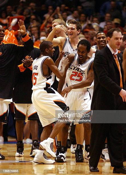 Oklahoma State celebrates their win over Pittsburgh at the Continental Airlines Arena in East Rutherford New Jersey March 25 2004 Oklahoma State beat...