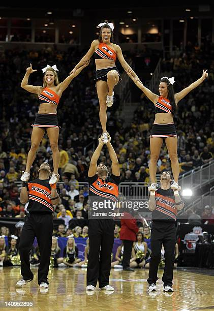 Oklahoma State Cowboy cheerleaders in formation during the NCAA Big 12 basketball tournament quarterfinal game against the Missouri Tigers on March 8...