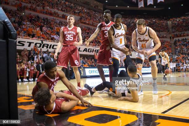 Oklahoma State Cowboys and Oklahoma Sooners get tangled up under the basket during the college Big 12 conference mens basketball game between the...