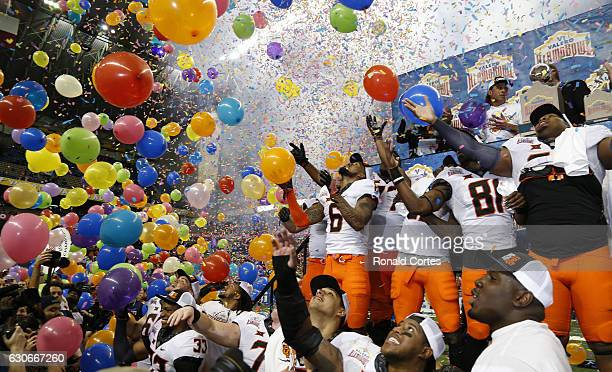 Oklahoma State Cowboys celebrate their victory over the Colorado Buffaloes in the Valero Alamo Bowl at the Alamodome on December 29 2016 in San...