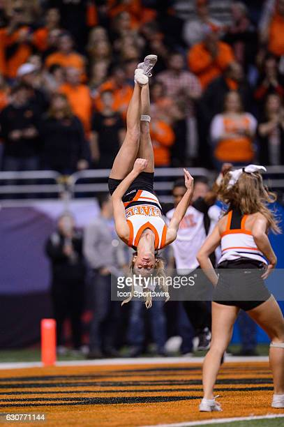 Oklahoma State Cowboys cheerleader flips through the end zone during the Valero Alamo Bowl between the Colorado Buffaloes and Oklahoma State Cowboys...