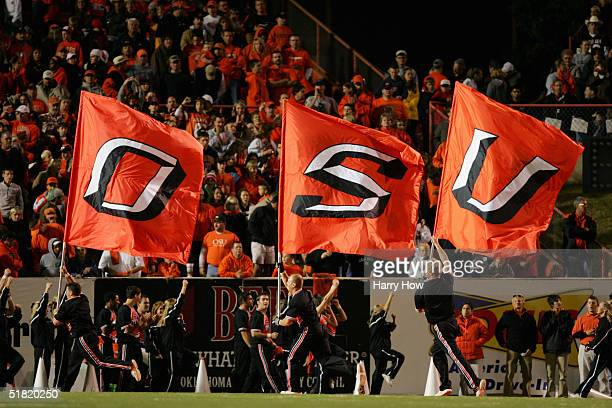 Oklahoma State Cowboys cheerleaders entertain the crowd during the game against the Texas A&M Aggies at Boone Pickens Stadium on October 16, 2004 in...
