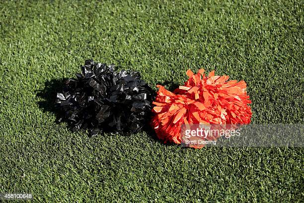 Oklahoma State Cowboys cheerleaders pom pons lay on the field during the game against the West Virginia Mountaineers October 25 2014 at Boone Pickens...