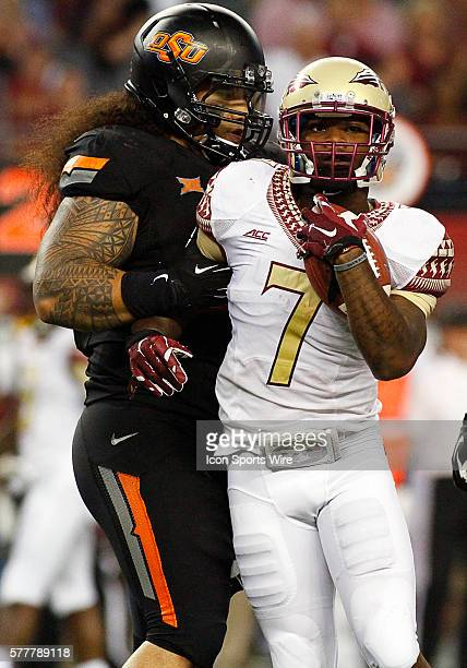 Oklahoma State Cowboys defensive tackle Ofa Hautau and Florida State Seminoles quarterback Jameis Winston during a NCAA football game between the...