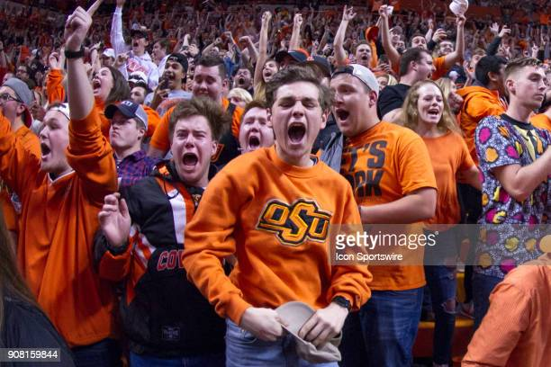 Oklahoma State Cowboys fans rush the court after winning the college Big 12 conference mens basketball game between the Oklahoma Sooners and the...
