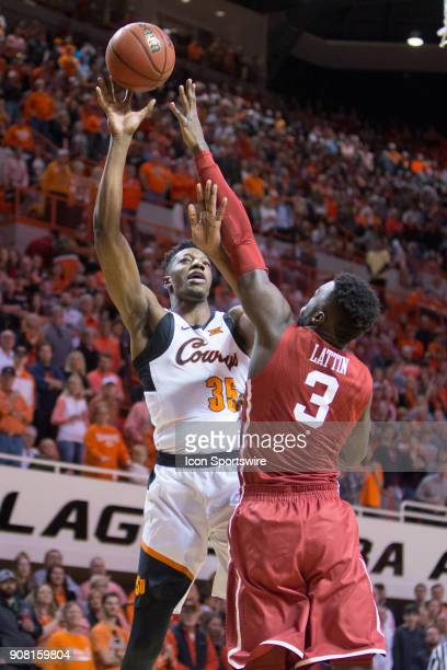 Oklahoma State Cowboys forward Yankuba Sima puts up a shot during the college Big 12 conference mens basketball game between the Oklahoma Sooners and...