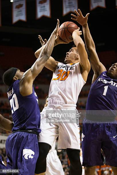 Oklahoma State Cowboys guard Jeffrey Carroll puts up a shot during the Big 12 Mens basketball game between the Kansas State Wildcats and the Oklahoma...