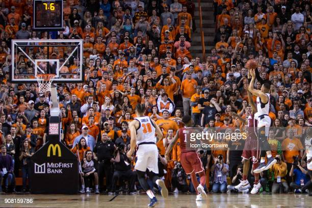 Oklahoma State Cowboys guard Kendall Smith puts up a three point shot to tie the game forcing overtime during the college Big 12 conference mens...