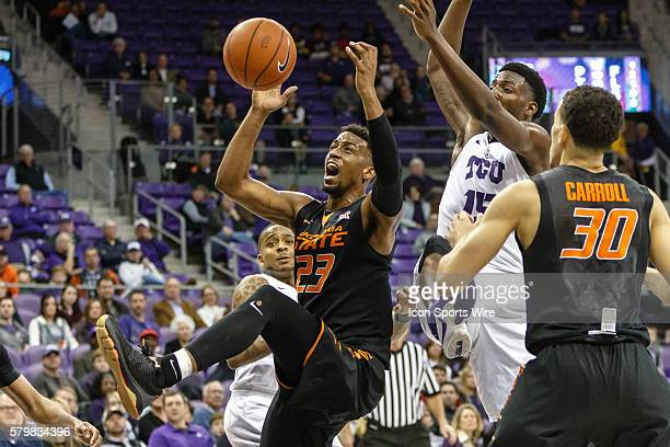 Oklahoma State Cowboys guard Leyton Hammonds fights for a rebound during the NCAA Basketball game between the Oklahoma State Cowboys and TCU Horned...