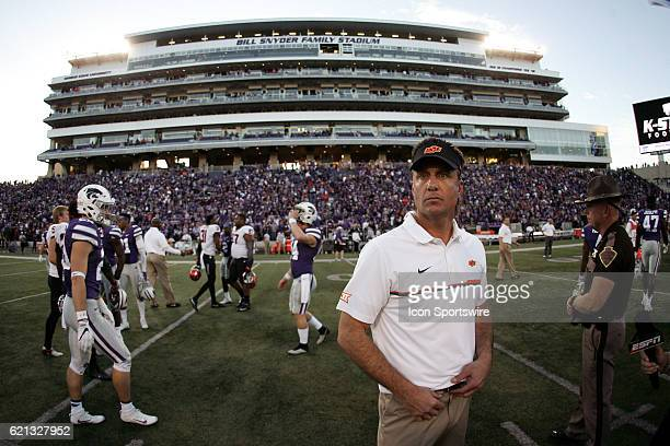 Oklahoma State Cowboys head coach Mike Gundy congratulates players after the game against the Kansas State Wildcats on November 5 at Bill Snyder...