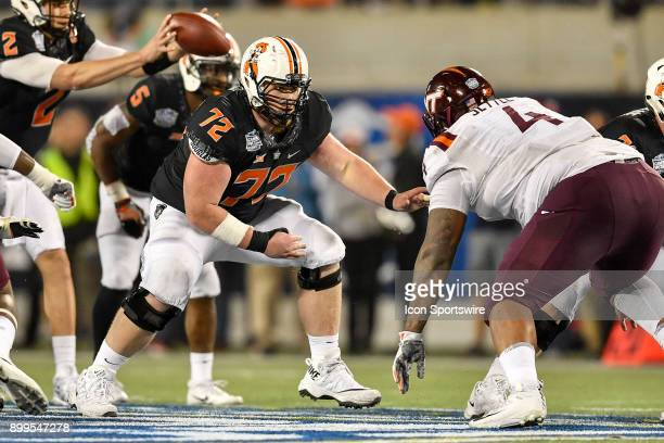 Oklahoma State Cowboys offensive lineman Johnny Wilson drops back to pass protect during the second half of the Camping World Bowl game between the...