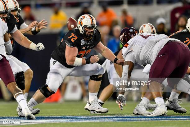 Oklahoma State Cowboys offensive lineman Johnny Wilson prepares to block during the first half of the Camping World Bowl game between the Virginia...