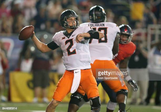 Oklahoma State Cowboys quarterback Mason Rudolph drops back to pass during a football game between the South Alabama Jaguars and the Oklahoma State...