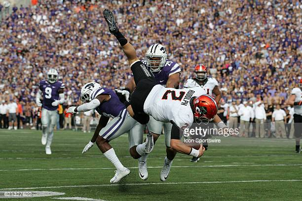 Oklahoma State Cowboys quarterback Mason Rudolph flies through the air after a hit from Kansas State Wildcats defensive back Duke Shelley during the...