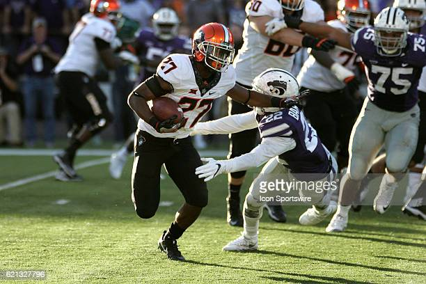 Oklahoma State Cowboys running back Justice Hill shakes a tackle by Kansas State Wildcats defensive back Dante Barnett during the Oklahoma State...