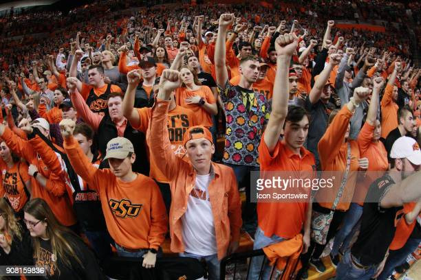 Oklahoma State Cowboys student fans in the last seconds of the college Big 12 conference mens basketball game between the Oklahoma Sooners and the...