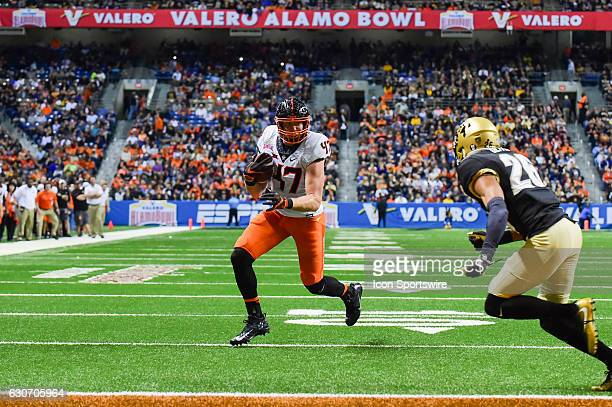 Oklahoma State Cowboys tight end Blake Jarwin turns upfield for a 3rd quarter touchdown during the game between the Oklahoma State Cowboys and...