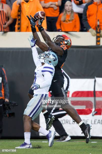 Oklahoma State Cowboys wide receiver James Washington goes up for a reception during the Big 12 college football game between the Kansas State...