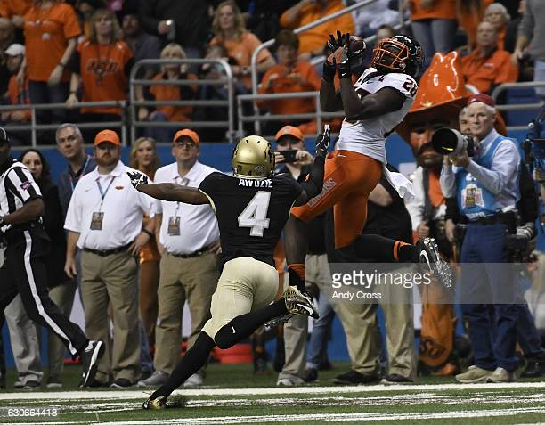 Oklahoma State Cowboys wide receiver James Washington makes a catch for long yardage against Colorado Buffaloes defensive back Chidobe Awuzie in the...