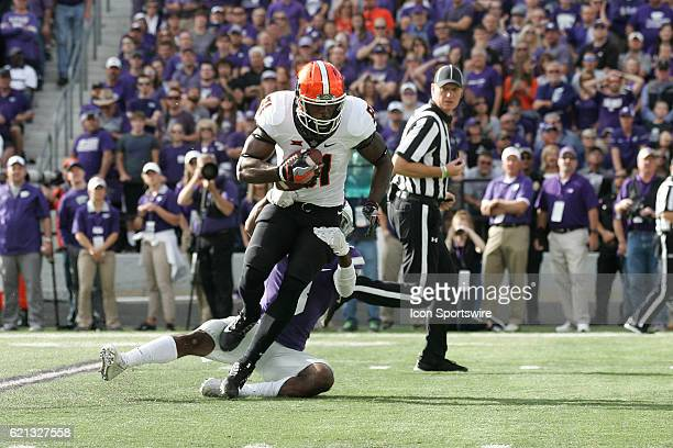 Oklahoma State Cowboys wide receiver Jhajuan Seales is tackled by Kansas State Wildcats defensive back Duke Shelley during the Oklahoma State Cowboys...