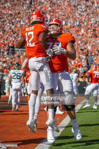 Oklahoma State Cowboys wide receiver Jordan McCray and Oklahoma State Cowboys offensive lineman Johnny Wilson celebrate after scoring during the Big...