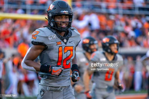 Oklahoma State Cowboys wide receiver Jordan McCray in the end zone after scoring during the college football game against the McNeese State Cowboys...