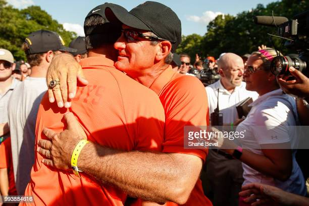 Oklahoma State head coach Alan Bratton embraces a player after the Cowboys won the Division I Men's Golf Team Match Play Championship held at the...